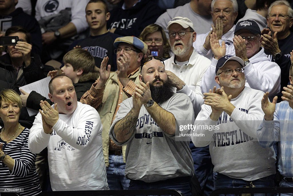 Wrestling fans of the Penn State Nittany Lions cheer during a match against of the Oklahoma State Cowboys on February 16, 2014 at Rec Hall on the campus of Penn State University in State College, Pennsylvania. Penn State won 23-12.