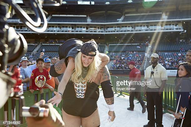 Legends of Wrestling Tyrus carrying out Ashley Massaro out of stadium after losing match vs Brian Myers at Citi Field Flushing NY 6/7/2015 CREDIT...