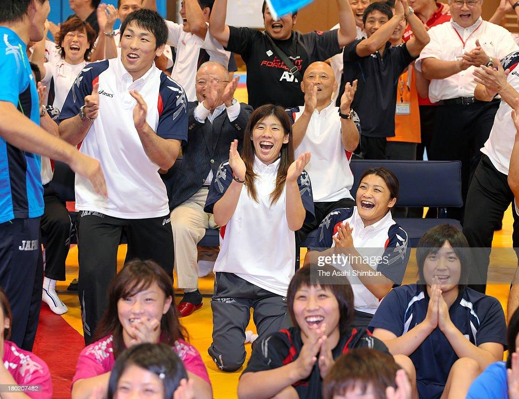 Wrestling Olympic gold medalists Saori Yoshida Kaori Ichio and Tatsuhiro Yonemitsu celebrate with local residents as wrestling was voted to be...