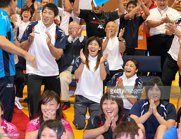 Wrestling Olympic gold medalists Saori Yoshida Kaori Ichio and Tatsuhiro Yonemitsu celebrate with local residents as wrestling was voted to be...