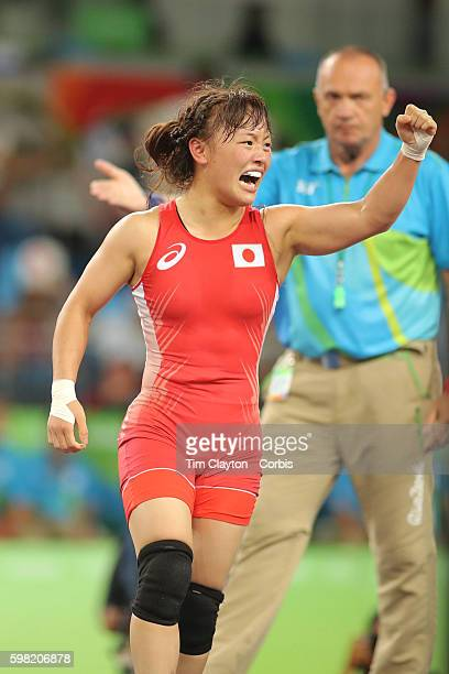 Day 12 Eri Tosaka of Japan celebrates her dramatic last second victory against Mariya Stadnik of Azerbaijan during their Women's Freestyle 48 kg Gold...