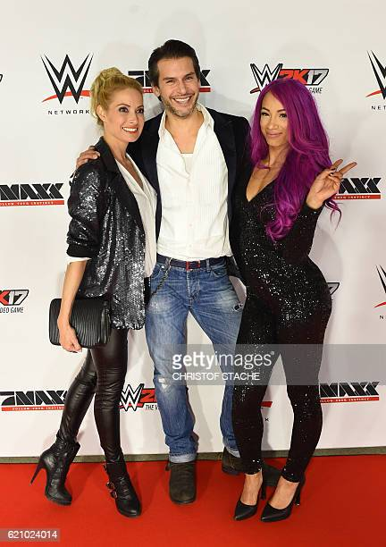 WWE wrestling star Sasha Bank German actor Florian Odenthal and sky host Sarah Winkhaus pose on the red carpet prior to the WWE SixManTagTeamMatch...