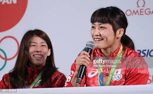 Wrestling Women's 58kg gold medalist Kaori Icho of Japan speaks while silver medalist in 53kg Saori Yoshida of Japan listens during the Japanese...