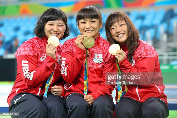 Wrestling Women's 69kg gold medalst Sara Dosho 58kg gold medalist Kaori Icho and 48kg gold medalist Eri Tosaka of Japan pose for photographs on Day...