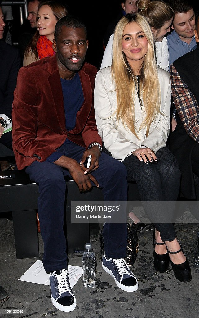 Wretch 32 and Zara Martin attend the Oliver Spencer show at the London Collections: MEN AW13 at The Old Sorting Office on January 8, 2013 in London, England.