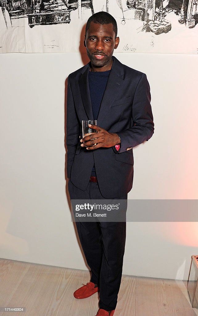 Wretch 32 attends the 'Arts For Life' charity auction hosted by Susan Hayden, Nadja Swarovski and Natalia Vodianova to raise funds for Borne, a research programme on premature birth, at the Saatchi Gallery on June 24, 2013 in London, England.