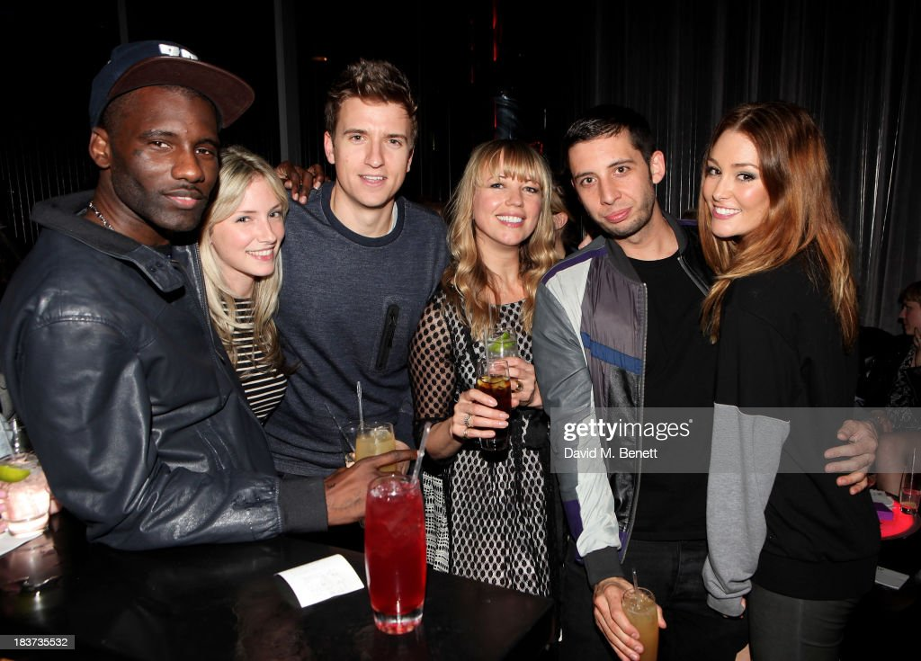 <a gi-track='captionPersonalityLinkClicked' href=/galleries/search?phrase=Wretch+32&family=editorial&specificpeople=5855963 ng-click='$event.stopPropagation()'>Wretch 32</a>, guest, Greg James, <a gi-track='captionPersonalityLinkClicked' href=/galleries/search?phrase=Sara+Cox&family=editorial&specificpeople=208641 ng-click='$event.stopPropagation()'>Sara Cox</a>, Example and <a gi-track='captionPersonalityLinkClicked' href=/galleries/search?phrase=Erin+McNaught&family=editorial&specificpeople=885741 ng-click='$event.stopPropagation()'>Erin McNaught</a> attend the launch of The Vinyl Collection curated by Annie Mac and the AMP 2013 album at W London - Leicester Square on October 9, 2013 in London, England.