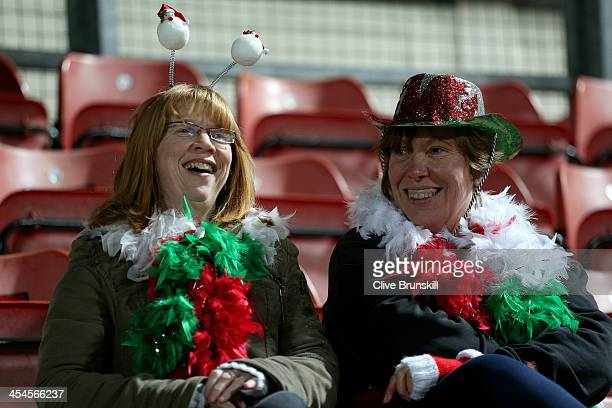 Wrexham AFC fans in good spirits during the FA Cup Second Round match between Wrexham AFC and Oxford United at Racecourse Ground on December 9 2013...
