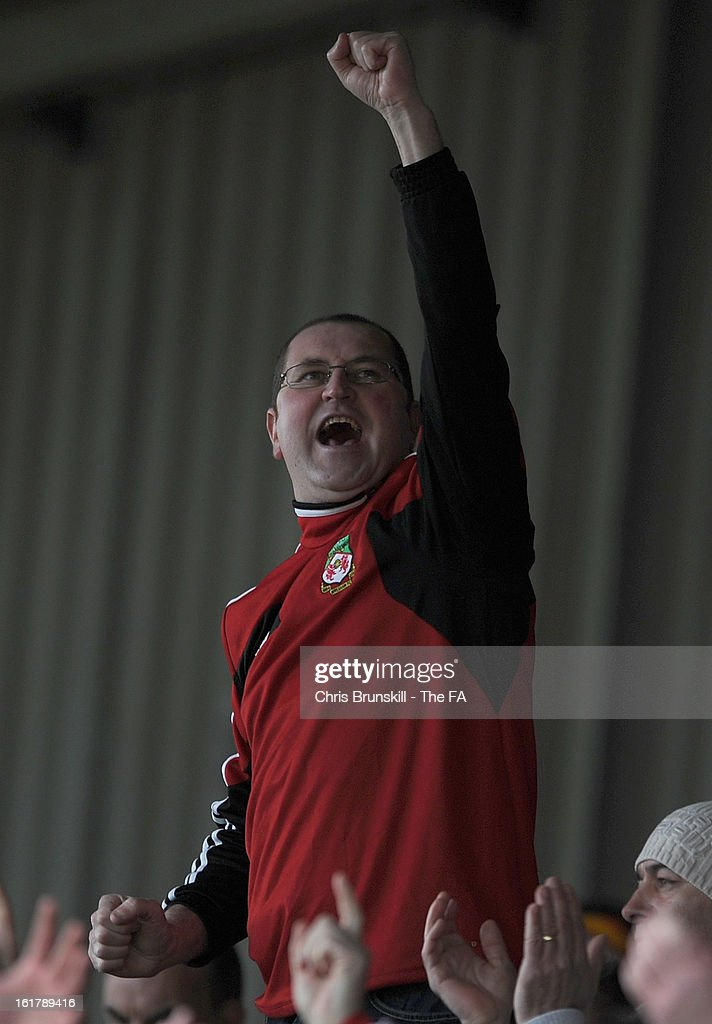 A Wrexham fan celebrates at full-time following the FA Trophy Semi-Final match between Wrexham and Gainsborough Trinity at the Racecourse Ground on February 16, 2013 in Wrexham, Wales.