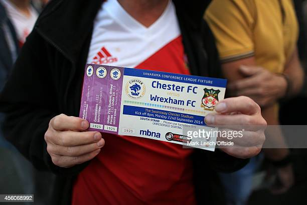 Wrexham fan displays his match ticket prior to the Vanarama Conference match between Chester and Wrexham at the Deva Stadium on September 22 2014 in...