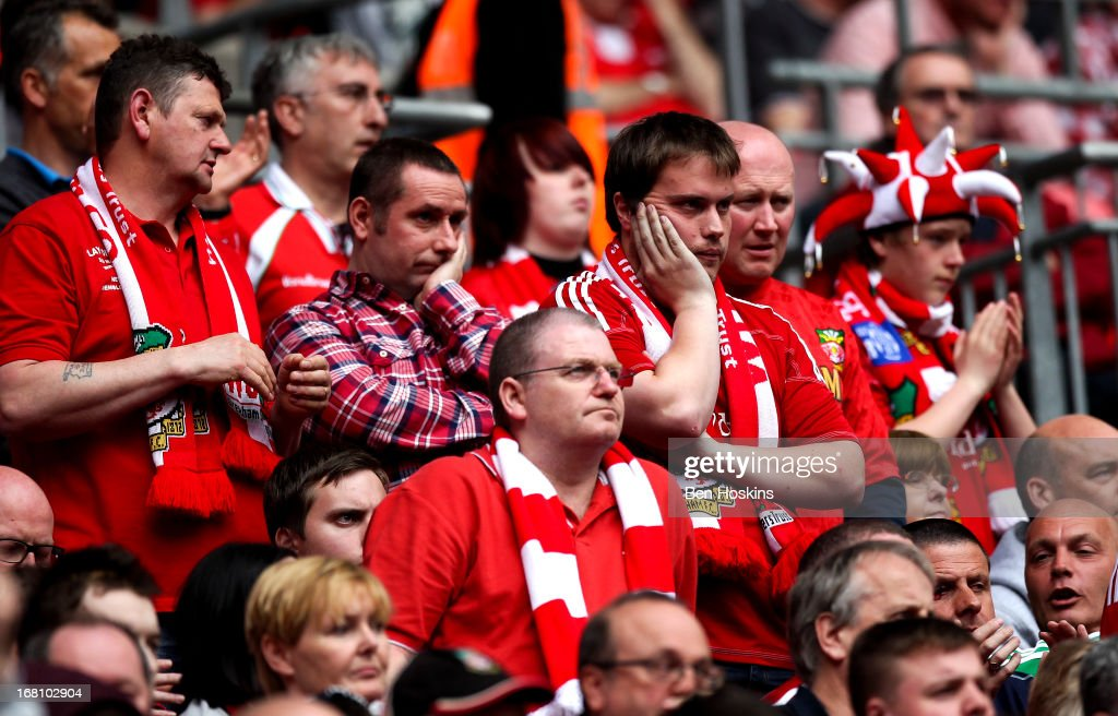Wrexham fans look dejected during the Blue Square Bet Premier Conference Play-off Final match between Wrexham and Newport County A.F.C at Wembley Stadium on May 05, 2013 in London, England.