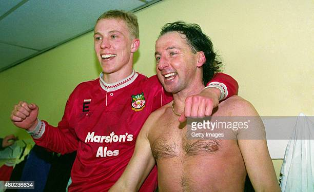 Wrexham goalscorers Steve Watkin and Mickey Thomas celebrate in the dressing room after League Division Four side Wrexham had beaten Division One...
