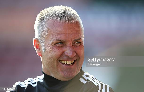 Wrexham manager Gary Mills looks on during the pre season friendly match between Wrexham and Stoke City at Racecourse Ground on July 22 2015 in...
