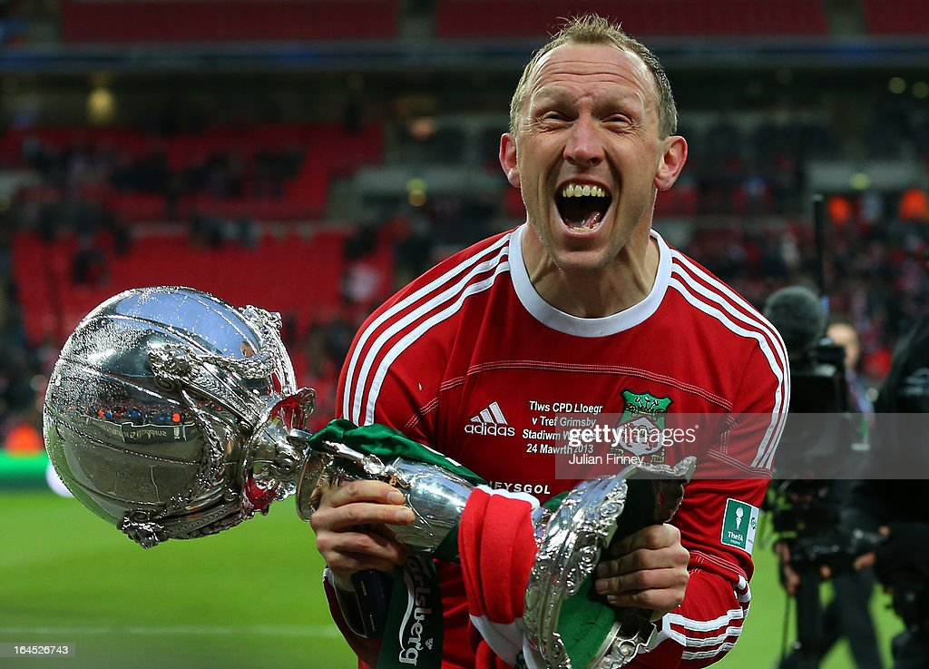 Wrexham player manager Andy Morrell celebrates with the trophy during the FA Trophy Final match between Wrexham and Grimsby Town at Wembley Stadium on March 24, 2013 in London, England.