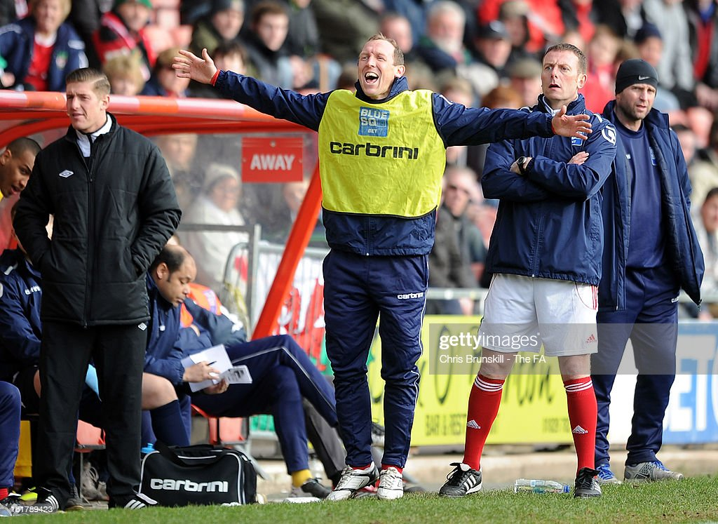 Wrexham player-manager Andy Morrell gestures on the touchline during the FA Trophy Semi-Final match between Wrexham and Gainsborough Trinity at the Racecourse Ground on February 16, 2013 in Wrexham, Wales.