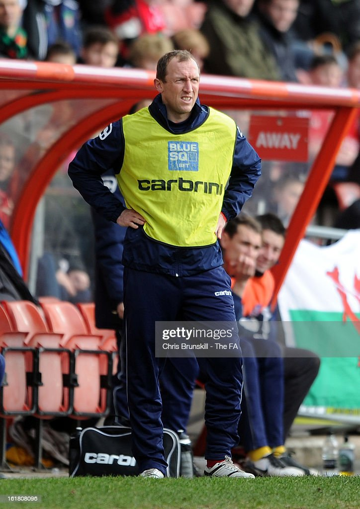 Wrexham player-manager Andy Morrell looks on during the FA Trophy Semi-Final match between Wrexham and Gainsborough Trinity at the Racecourse Ground on February 16, 2013 in Wrexham, Wales.