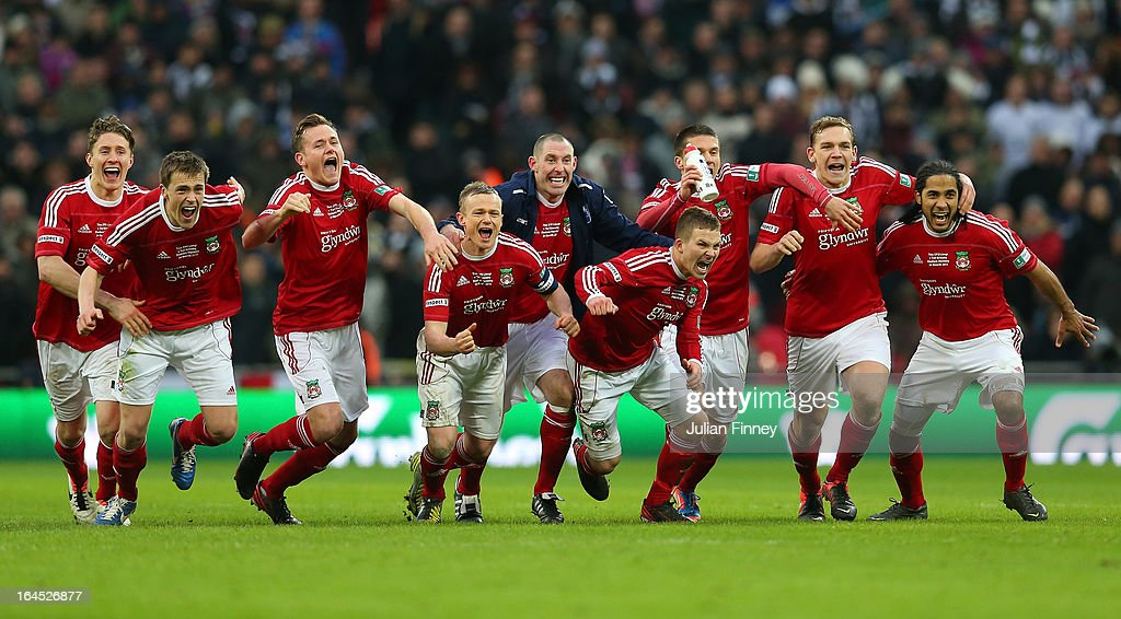 Wrexham players celebrate after a penalty shoot during the FA Trophy Final match between Wrexham and Grimsby Town at Wembley Stadium on March 24, 2013 in London, England.
