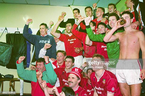 Wrexham players including Joey Jones Gordon Davies and team mates celebrate in the dressing room after League Division Four side Wrexham had beaten...