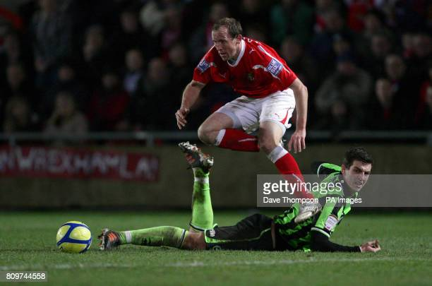Wrexham's Andy Morrell jumps over Brighton and Hove Albion's Lewis Dunk during the FA Cup Third Round Replay at The Racecourse Ground Wrexham