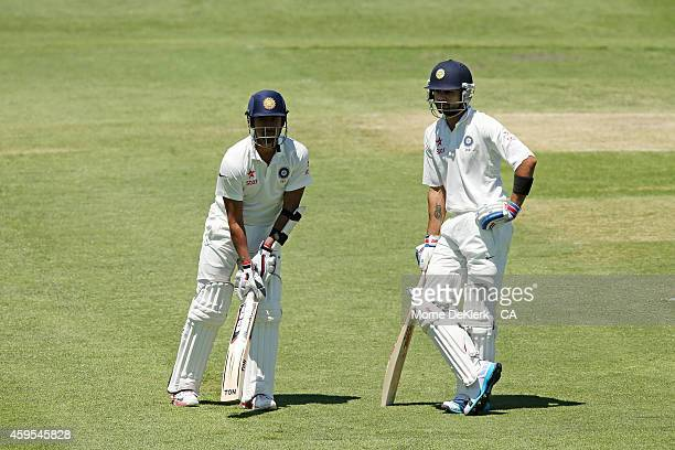 Wriddhiman Saha and Virat Kohli of India look on during day two of the tour match between CA XI and India at Gliderol Stadium on November 25 2014 in...