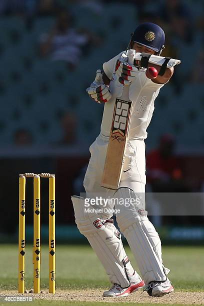 Wriddhiman Saha of India is hit by a bouncer from Mitchell Johnson of Australia during day three of the First Test match between Australia and India...