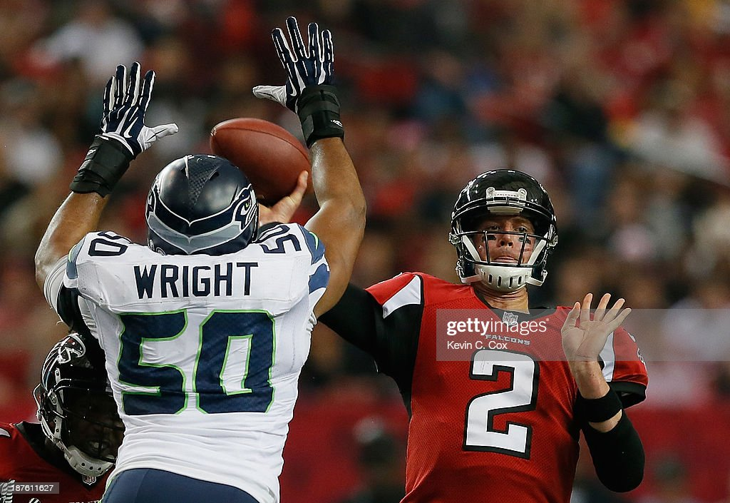 K.J. Wright #50 of the Seattle Seahawks pressures Matt Ryan #2 of the Atlanta Falcons at Georgia Dome on November 10, 2013 in Atlanta, Georgia.