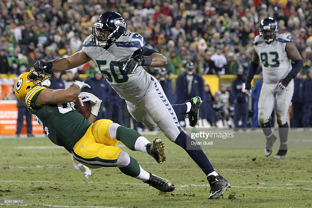 K.J. Wright #50 of the Seattle Seahawks tackles Richard Rodgers #82 of the Green Bay Packers during the second half of a game at Lambeau Field on December 11, 2016 in Green Bay, Wisconsin.