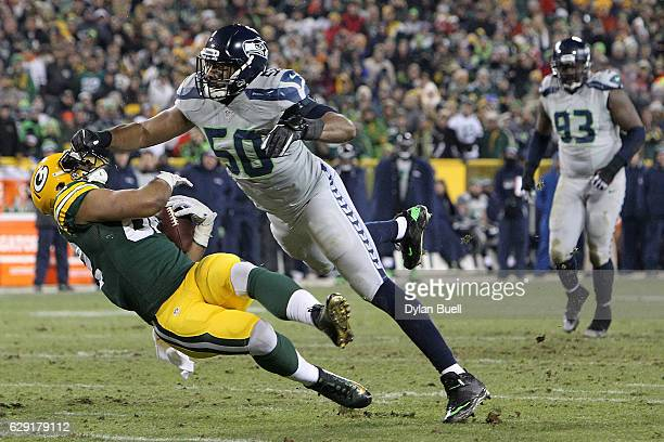 J Wright of the Seattle Seahawks tackles Richard Rodgers of the Green Bay Packers during the second half of a game at Lambeau Field on December 11...