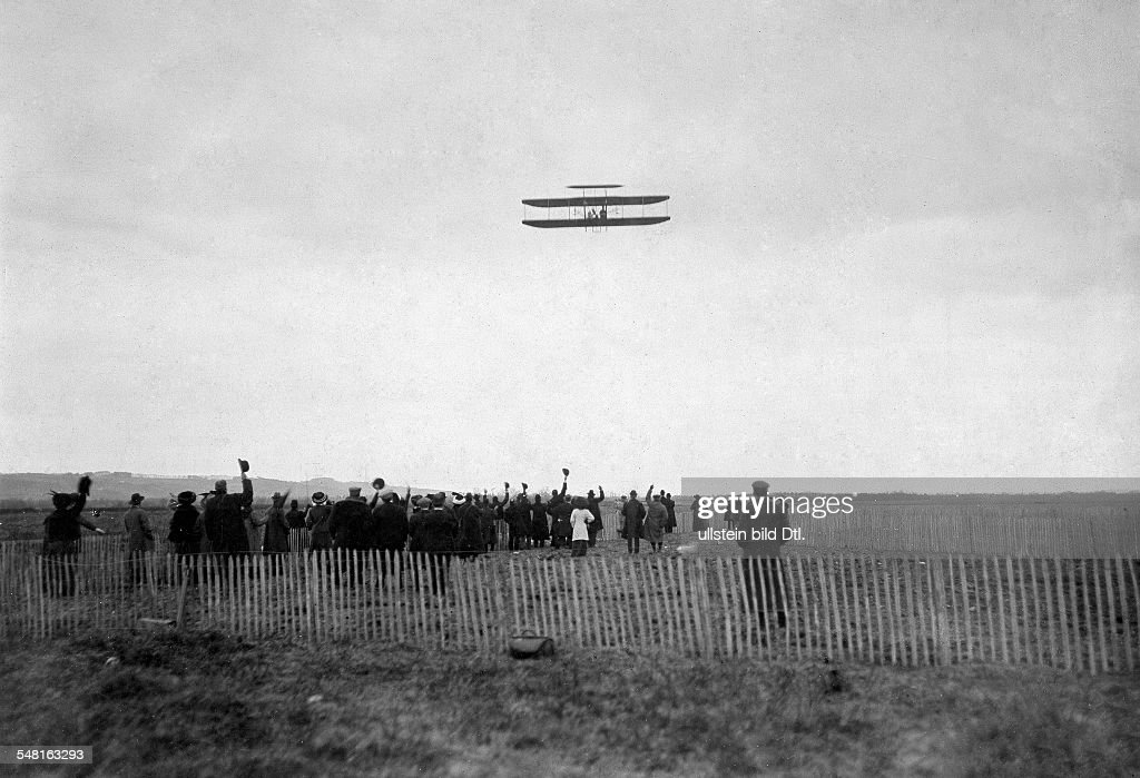 Wright Orville and Wilbur Pioneers of aviation inventors of the first engine powered aircraft USA Wilbur Wright's flight near Pau France 1908...