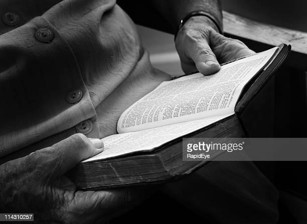 Wrinkled hands, old Bible