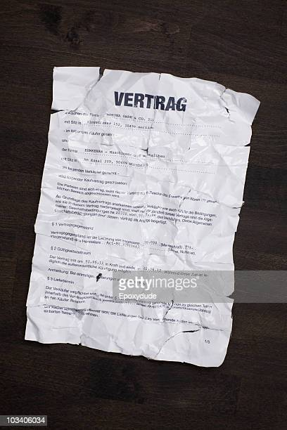 A wrinkled, torn, German sales contract taped together and flattened out