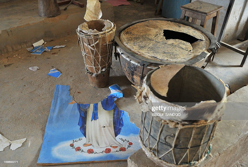 A wripped up image of the Virgin Mary and broken music instruments are left on the ground of a Catholic church in Diabaly, on January 22, 2013. The EU executive today announced 20 million euros of extra humanitarian aid to help tens of thousands of Malians fleeing fighting in the nation's north and centre, its second such donation in as many months.
