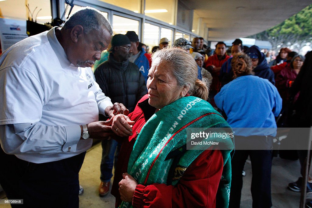 Wristbands are checked as people are allowed to enter numerically at the Remote Area Medical (RAM) clinic at the Los Angeles Sports Arena on April 27, 2010 in Los Angeles, California. More than 6,000 people were given wristbands over the weekend, some of them waiting overnight, to receive the free medical, dental and vision care. RAM hopes to treat 8,400 patients at the event which runs from April 27 to May 3. A Los Angeles-area RAM event in 2009 provided more than 14,500 services to approximately 6,344 patients. Los Angeles is reportedly home to 2.2 million uninsured people.