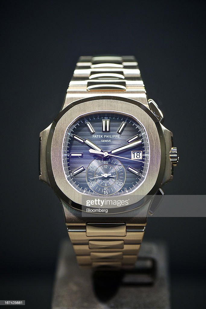 A 5880/1 wristwatch, manufactured by Patek Philippe SA, sits on display during the Baselworld watch fair in Basel, Switzerland, on Wednesday, April 24, 2013. The annual fair attracts 2,000 companies from the watch, jewelry and gem industries to show their new wares to more than 100,000 visitors. Photographer: Gianluca Colla/Bloomberg via Getty Images