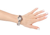 Wristwatch on a female hand on a white background isolation