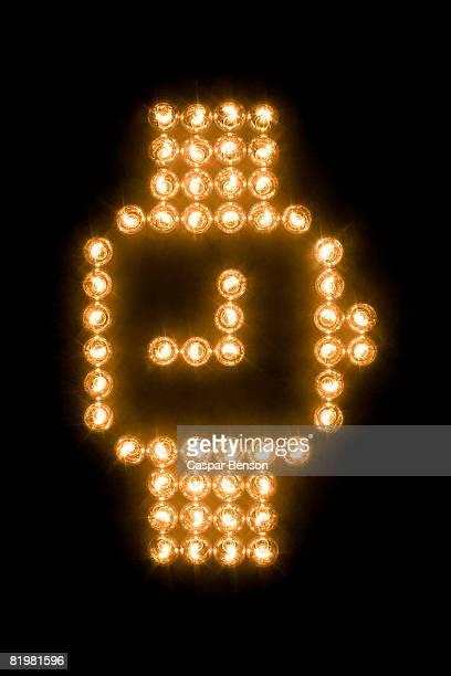 Wristwatch symbol made with illuminated light bulbs