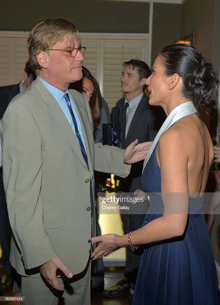 "Writer Aaron Sorkin (L) and actress Olivia Munn wearing Juicy Couture attend Vanity Fair and Juicy Couture's Celebration of the 2013 ""Vanities"" Calendar hosted by Vanity Fair West Coast Editor Krista Smith and actress Olivia Munn in support of the Regional Food Bank of Oklahoma, a member of Feeding America, at the Chateau Marmont on February 18, 2013 in Los Angeles, California."