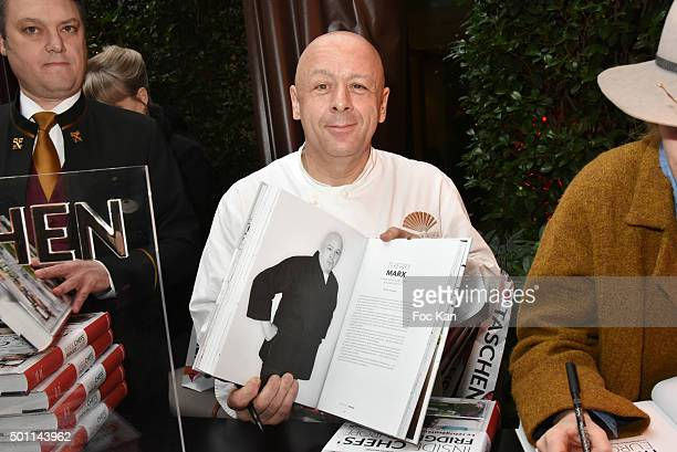 Writer Adrian Moore from Mandarin Oriental and Chef Thierry Marx of Mandarin Oriental restaurant attend the Thierry Marx Inside Chefs' Fridges book...