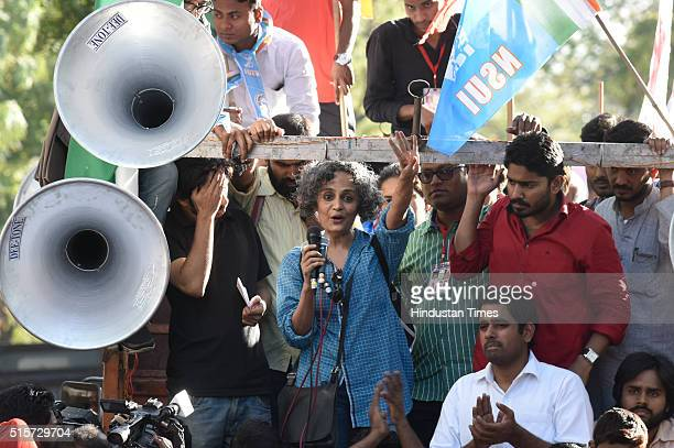 Writer and activist Arundhati Roy speaks to gathering after the march from Mandi House to Parliament to demand the release of Umar Khalid and Anirban...