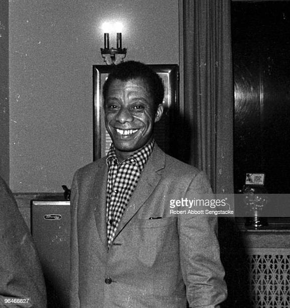 Writer and author James Baldwin standing in a hotel lobby while in Montgomery to participate in the Selma to Montgomery march late March 1965