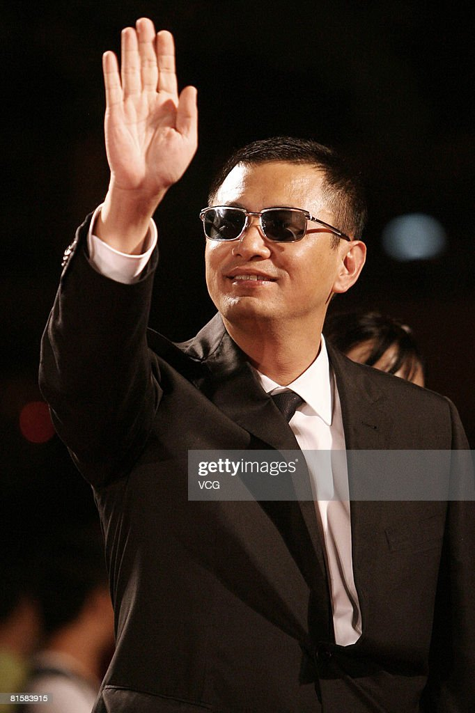 Writer and director Kar-Wai Wong arrives at the opening ceremony of the 11th Shanghai Film Festival on June 14, 2008 in Shanghai, China.
