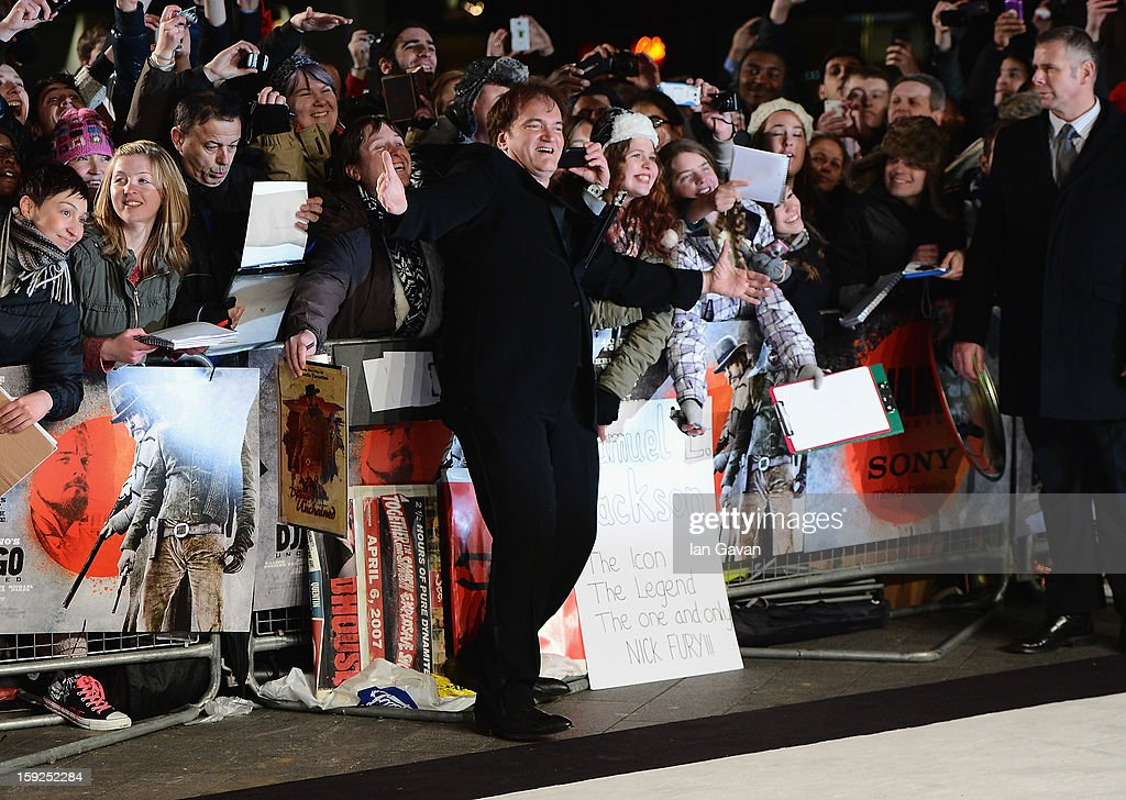 Writer and director Quentin Tarantino poses with fans as he attends the UK Premiere of 'Django Unchained' at the Empire Leicester Square on January 10, 2013 in London, England.