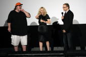 Writer and executive producer Madonna stands with filmmaker Michael Moore and director Nathan Rissman onstage at The State Theater for a screening of...