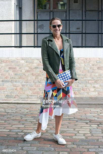 Writer and Fashion Stylist Laurel Pantin wears a Rebecca Minkoff jacket Preen dress Purified shoes and Prada sunglasses on day 3 during London...