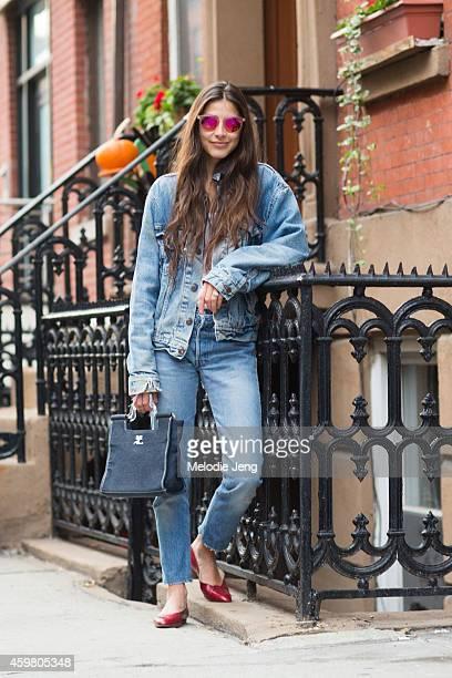 Writer and founder of Definer app Felicity Sargent wears a vintage Levi's denim jacket Club Monaco tshirt vintage Redun jeans Chanel flats and...