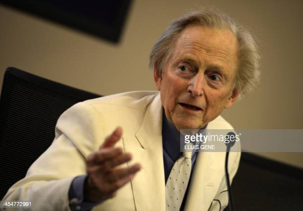 US writer and journalist Tom Wolfe gestures during the presentation of his new book 'Bloody Miami' at La Pedrera building in Barcelona on December 10...