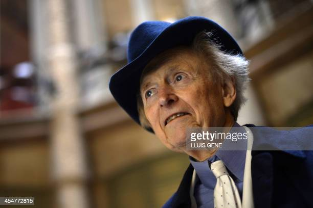 US writer and journalist Tom Wolfe looks on as he poses during the presentation of his new book 'Bloody Miami' at La Pedrera building in Barcelona on...