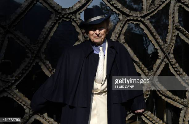 US writer and journalist Tom Wolfe smiles as he poses during the presentation of his new book 'Bloody Miami' at La Pedrera building in Barcelona on...