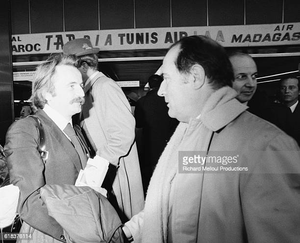 Writer and philosopher Regis Debray and First Secretary of the French Socialist Party Francois Mitterrand shake hands in the airport in Paris Debray...