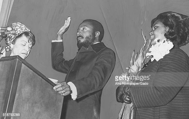 Writer and social activist Dick Gregory and AfricanAmerican Civil Rights lawyer Jean Williams delivering a speech and taking an oath March 15 1969